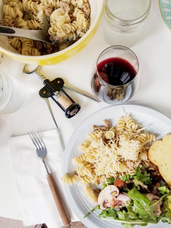 Free stock photo Homemade dinner with pasta, salad and a glass of red wine